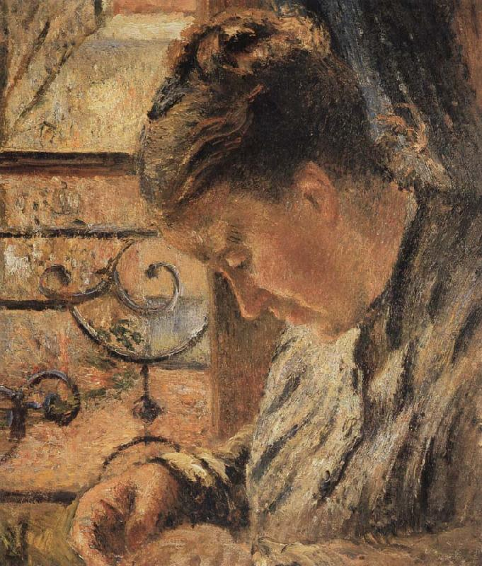 Camille Pissarro The Woman is sewing in front of the window